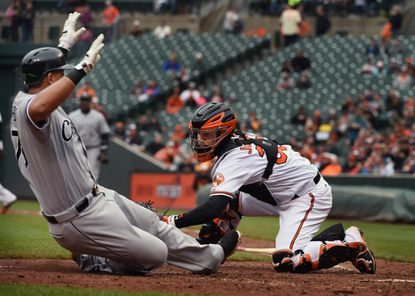 Orioles catcher Caleb Joseph, right, tags out White Sox's Jose Abreu, left, who tries to score on a single by Melky Cabrera in the fifth inning. The White Sox defeated the Orioles by score of 7 to 1 at Oriole Park at Camden Yards.