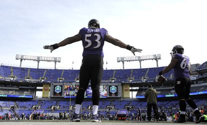 Ravens center Jeremy Zuttah stretches before a game last season against the Tennessee Titans.