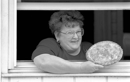 In this photo from 1996, Faye Furr shows off one of her homemade pies.