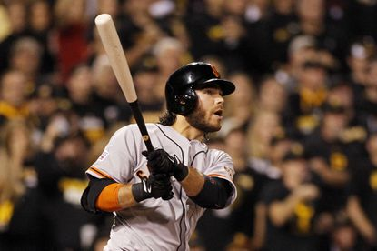 San Francisco Giants shortstop Brandon Crawford hits a grand slam in the fourth inning against the Pittsburgh Pirates during the National League Wild Card game.