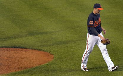 Orioles closer Jim Johnson walks off the mound after blowing his third save of the season Friday night against the A's.