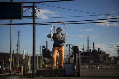 A statue of a steel worker stands near the entrance to U.S. Steel Edgar Thomson Steel Works, March 10, 2018, in Braddock, Pa. Trump visited the state on Saturday evening for a rally with Republican Congressional candidate Rick Saccone.