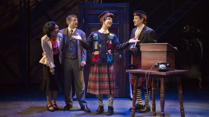 """Robbie Gay, Kathryn Tkel, Michael Wood and Noah Israel in a scene from Rep Stage's production of """"The 39 Steps."""""""