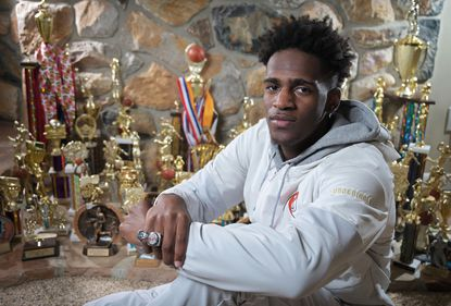 Poly senior basketball player Rahim 'Rah' Ali sits in his home with the many accolades he has received, Sat., Nov. 23, 2019.