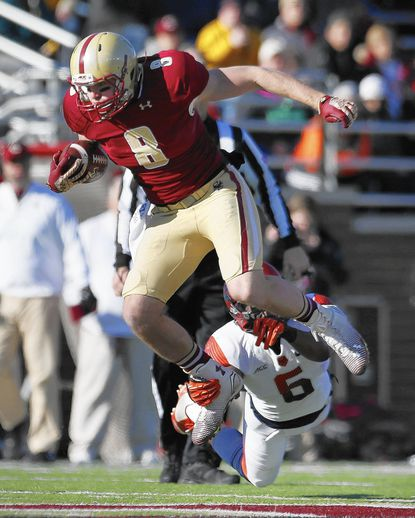 Syracuse safety Ritchy Desir (6) grabs Boston College wide receiver Josh Bordner (8) during the first quarter of an NCAA college football game in Boston, Saturday, Nov. 29, 2014. (AP Photo/Michael Dwyer) ** Usable by LA, DC, CGT and CCT Only **