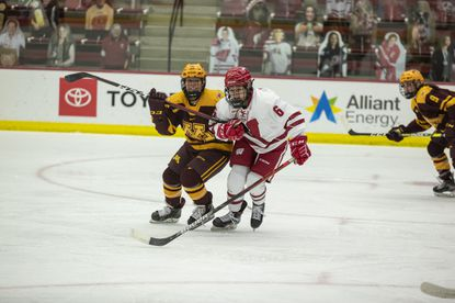 Wisconsin forward Lacey Eden (6), an Annapolis native, fights off a player during an NCAA women's hockey game against Minnesota on Jan. 15 in Madison, Wisconsin.