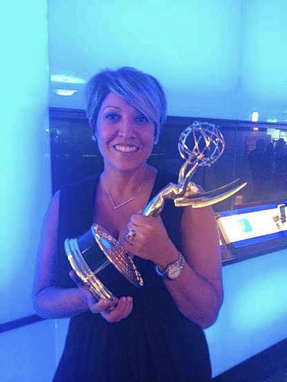 """Glenelg High alumna Meagan Lewis shows off the Emmy she won for casting the TV series """"True Detective."""""""