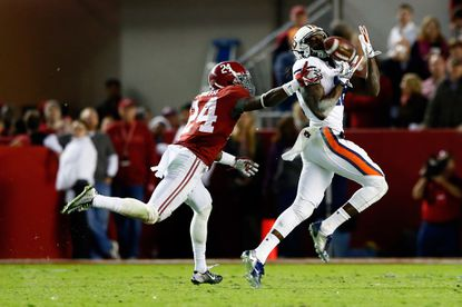 Auburn's Sammie Coates catches a 53-yard pass in the fourth quarter of the Iron Bowl against Alabama on Nov. 29.