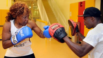 Franchon Crews and her husband, Glenn Dezurn, work out at the University of Maryland gym downtown on Aug. 6, 2014.