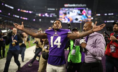 Minnesota Vikings wide receiver Stefon Diggs stands elated in the end zone, facing a U.S. Bank Stadium crowd in the throes of delirium, after catching the winning touchdown on the final play of the game against the New Orleans Saints in the NFC divisional playoff game on Sunday, January 14, 2018 at U.S. Bank Stadium in Minneapolis, Minn.