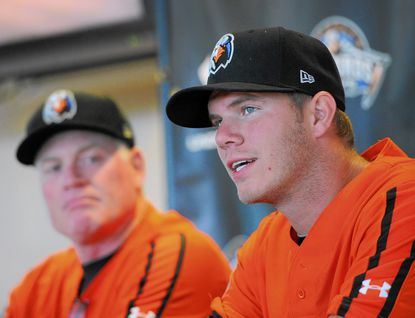 Orioles first-round draft pick pitcher Dylan Bundy, right, talks about his rehab assignment in Aberdeen during a press conference Thursday at Ripken Stadium in Aberdeen as IronBirds Manager Matt Merullo looks on.