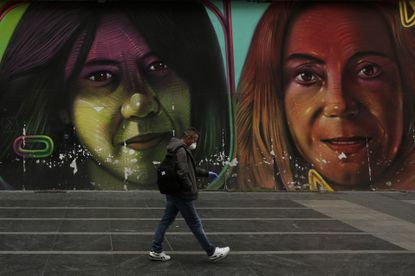A man wearing a face mask walks in downtown Madrid, Spain earlier this week as the country continues to deal with the coronavirus. Spain will mobilize 200 billion euros, or the equivalent to one fifth of the country's annual output in loans, credit guarantees and subsidies for workers and vulnerable citizens.