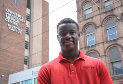 Kalen Jones poses for a portrait on the sidewalk outside of the University of Maryland Midtown Campus. Kalen is a rising junior at Baltimore Polytechnic Institute, and will be working remotely as a patient advocate for UMMC over the summer under the city's YouthWorks program.
