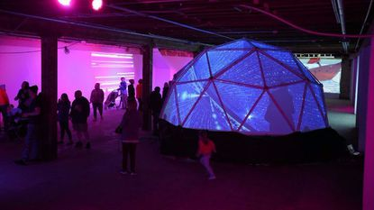 During the 2016 Light City festival, people gather to view Diana Reichenbach's HampdenLights installation. The satellite Neighborhood Lights celebration is being expanded to 14 communities for 2018.