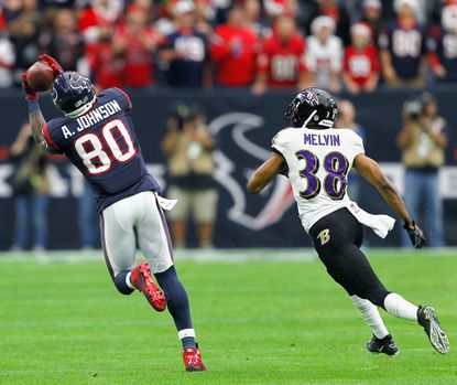 Andre Johnson makes a play against Ravens cornerback Rashaan Melvin in December. Could the veteran star receiver be a fit in Baltimore?