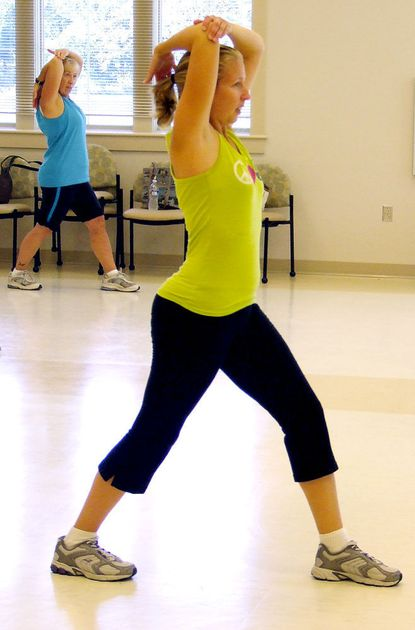 In this file photo, Linda Oechsler follows the moves of class instructor Katie Bernstein, foreground, through the cool-down segment of a Zumba Gold class at the South Carroll Senior and Community Center in 2010. Bernstein is one of the many certified instructors at Freedom Fitness who also teach classes at the senior center.
