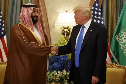 President Donald Trump shakes hands with Saudi Deputy Crown Prince and Defense Minister Mohammed bin Salman in Riyadh on May 20, 2017. In emails obtained by The Associated Press, George Nader claims he later met with bin Salman, who by then had been elevated to crown prince, and Abu Dhabi's crown prince in a lobbying effort to alter U.S. policy in the Middle East.