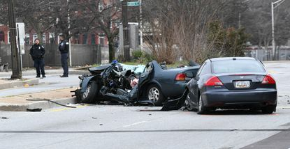 Police investigate a car accident on North Avenue near Eutaw Place in Baltimore.