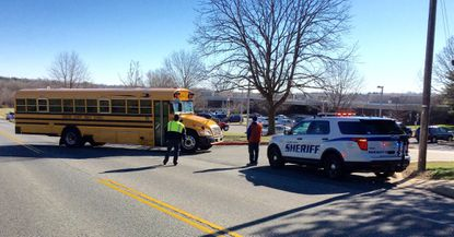 "A bus brings students back to Southampton Middle School early Monday afternoon, following a phoned in bomb threat that forced evacuation of the building. The students and staff went to a nearby church, while police investigated. The threat was deemed ""non-credible,"" according to a Harford County Public Schools spokesperson."