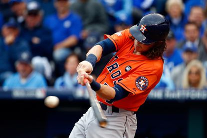 Colby Rasmus hits a solo home run in the third inning against Royals pitcher Johnny Cueto during Game 2 of the American League Division Series.