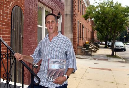"""Jeremy Diamond stands in the Sharp-Leadenhall neighborhood, where his grandfather once owned a corner grocery store. He has written a book called """"Tastemakers"""" about Jewish neighborhood-based grocers of Baltimore in the last 75 years. July 8, 2021"""