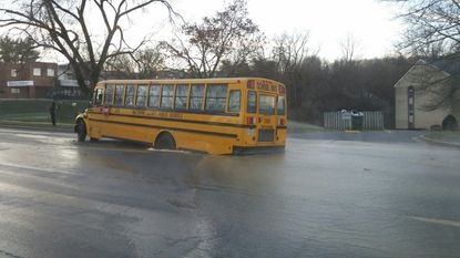School bus carrying Dulaney students gets stuck in sinkhole
