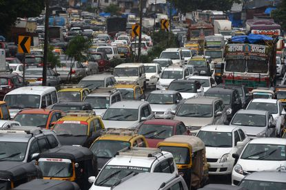 Heavy traffic is seen on a highway during heavy rain showers in Mumbai on September 4, 2019. (Photo by PUNIT PARANJPE / AFP) (Photo credit should read PUNIT PARANJPE/AFP/Getty Images)