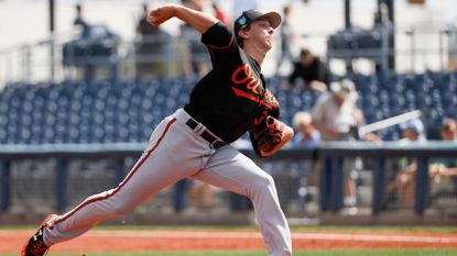 Baltimore Orioles starting pitcher Hunter Harvey throws in the second inning of a spring training baseball game against the Tampa Bay Rays, Tuesday, Feb. 27, 2018, in Port Charlotte, Fla. (AP Photo/John Minchillo)