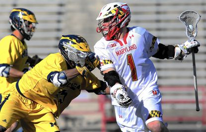 March 29, 2015: University of Maryland attacker Matt Rambo (1) tries to score around Michigan midfielder Chase Young (35) during a lacrosse match between the University of Maryland and the University of Michigan at Capital One Field at Byrd Stadium in College Park, Maryland. Photo by: Daniel Kucin Jr. Baltimore Sun No Mags, No Sales, No Internet, No TV