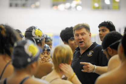 Laurel High swimming coach John Venit gives encouragement to his swimmers. Juniors Carolyn Sutton and Mia Rutherford have led the Spartans by advancing to Wednesday's Class 4A-3A state championships in Landover.