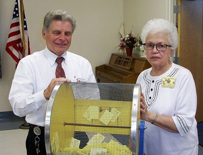 Richard Perron, left, assistant manager of the Safeway store in Eldersburg, drew the winning ticket for a $500 Safeway gift card during the May 2 meeting of the South Carroll Lioness-Lions Club at the Messiah Lutheran Church Celebration Hall in Berrett. Lion Mary Hartmann chaired the annual raffle, which raises funds for the club's community projects.