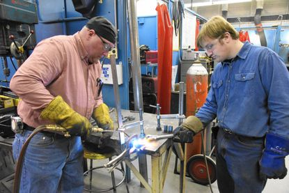 Welding instructor Mike Schweinsberg helps student William Rhoten in the welding classroom at the Carroll County Career and Technology Center in Westminster on January 6, 2017.