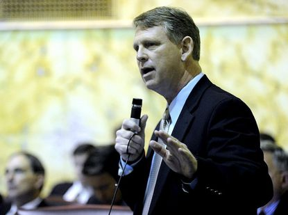 Sen. Allan Kittleman, R-District 9, speaks in support of the Civil Marriage Protection Act during a debate on the Senate flooor in Annapolis Thursday.