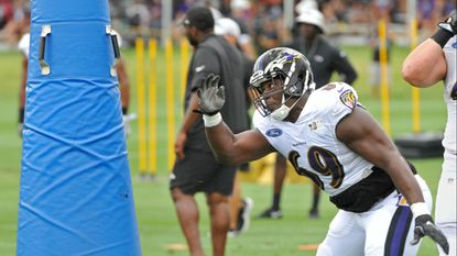 Former Ravens defensive tackle Willie Henry goes through a drill last season.