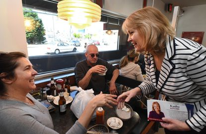 Michele Murphy, left, and Travis Murphy, center, Baltimore city residents, chat with Republican state Delegate Kathy Szeliga, campaigning for the Maryland Senate seat in the Republican primary at a 24-hour diner in Canton.