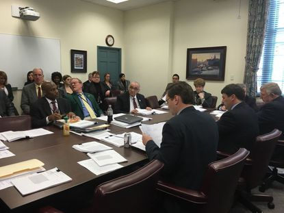 Members of a House-Senate conference committee meet to resolve differences on legislation that would enact broad reforms to Maryland's criminal justice system.