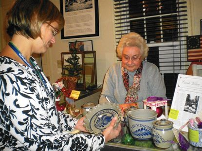 Curator Doris Pierce is shown processing a purchase at the New Windsor Heritage Museum. The museum is open on Saturdays and staffed by volunteers.