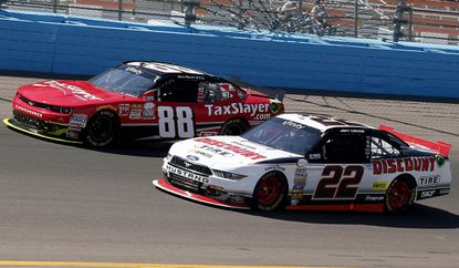 Joey Logano (22) and Kevin Harvick battle for the lead during the NASCAR Xfinity Series race on Saturday.