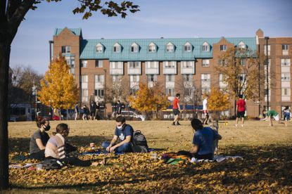 Masked students on the lawn at the Marquette University campus in Milwaukee, Wis. Democratic leaders are pressing the president-elect to cancel $50,000 in debt per student borrower by fast executive action, but he wants Congress to pass more modest relief.
