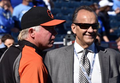 Orioles manager Buck Showalter (left) talks with Joe Torre before game four of the 2014 ALCS.