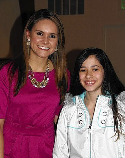"""Ava Marie meets Alisiana Tejada, one of her many """"weather fans,"""" at a program at the Fallston library on Jan. 9."""