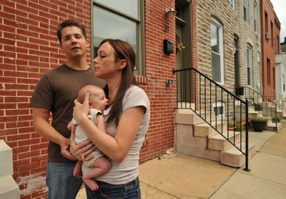 Joe and Kaitlin Eckard, with son, Joey, are among the many Baltimore City residents who will pay higher property taxes because of state miscalculations of historic tax credits.