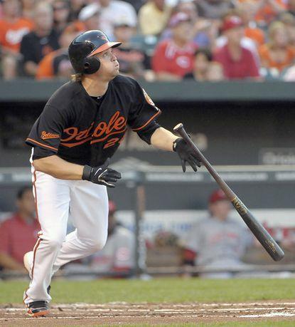 Orioles second baseman Blake Davis hits a second-inning triple.