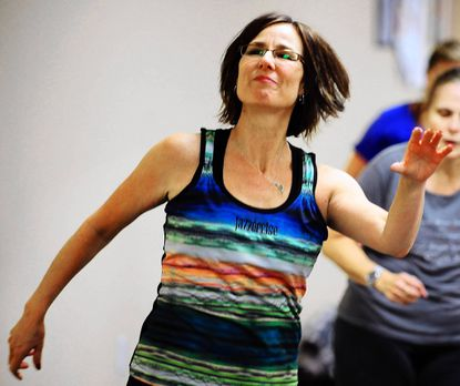 Penny Flora exercises in a jazzercise class led by Pamela Smith in Glen Burnie.