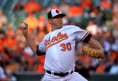 Baltimore Orioles starting pitcher Chris Tillman throws in the first inning to the Tampa Bay Rays during the second game of a day-night doubleheader at Oriole Park at Camden Yards on June 25, 2016.