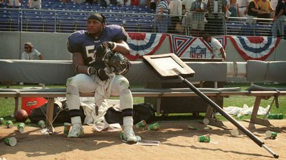 Linebacker Ray Lewis sits on the bench by himself after the Steelers beat the Ravens, 20-13, in the first regular-season game at then-Ravens Stadium on Sept. 6, 1998.