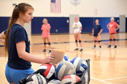 Victoria Howell, Manchester Valley's first year head volleyball coach, keeps a close eye on the progress of her players during a practice at the school on Wednesday, August 14.