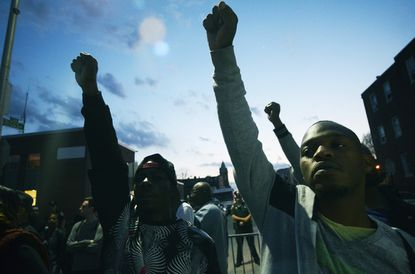 Marchers raised their fists during a protest at the Western District.