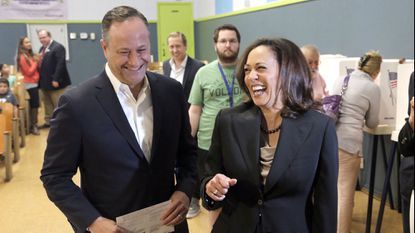FILE - In this Nov. 8, 2016, file photo, Kamala Harris, right, votes with her husband, Douglas Emhoff in Los Angeles.