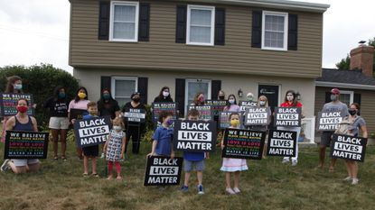 Springdale residents show solidarity outside of the home of resident Lana Hill, who's Black Lives Matters sign was stolen from the front of her yard.